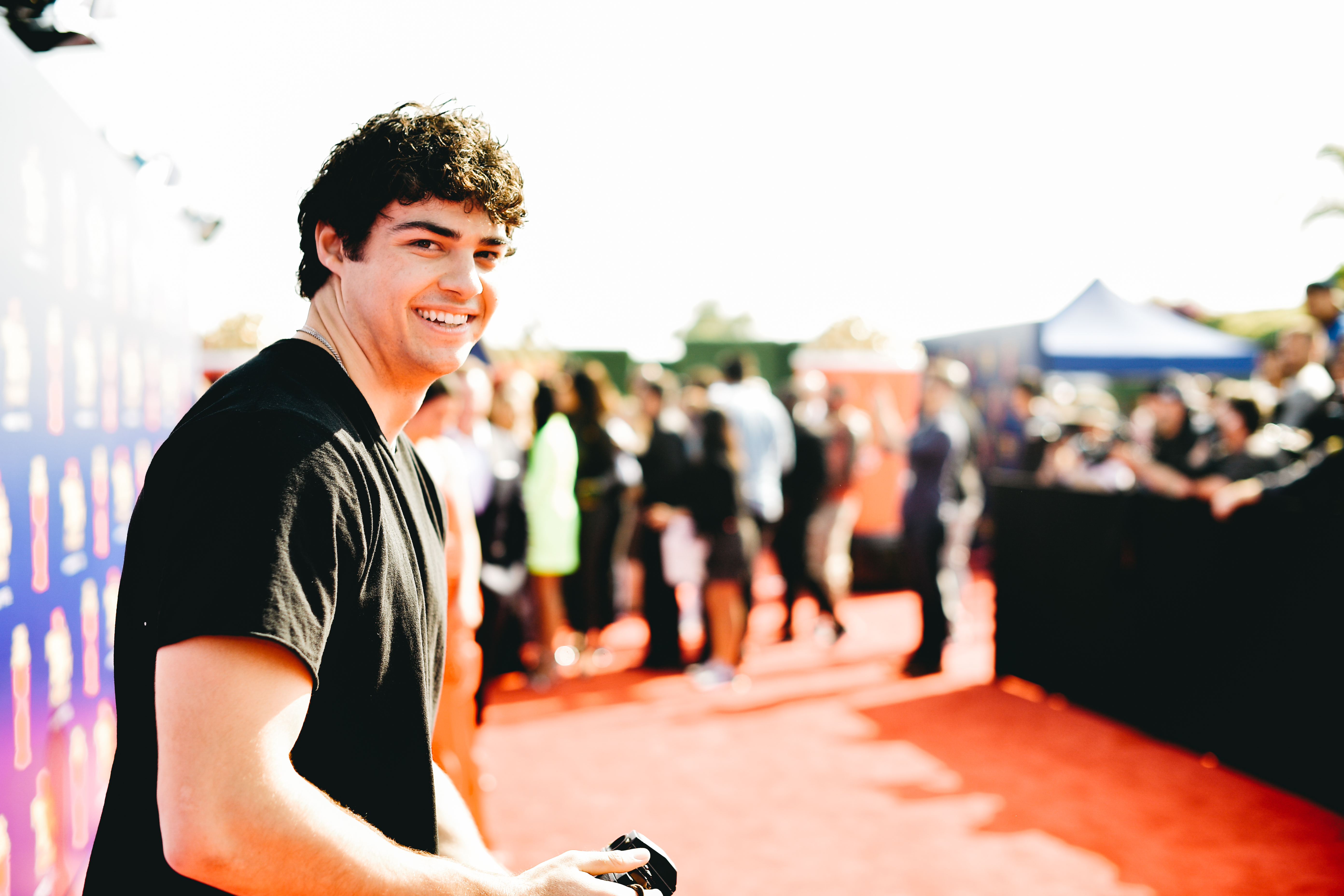 SANTA MONICA, CALIFORNIA - JUNE 15:  (EDITORS NOTE: Image has been processed using digital filters) Noah Centineo attends the 2019 MTV Movie and TV Awards Noah Centineo at Barker Hangar on June 15, 2019 in Santa Monica, California. (Photo by Matt Winkelmeyer/Getty Images for MTV)